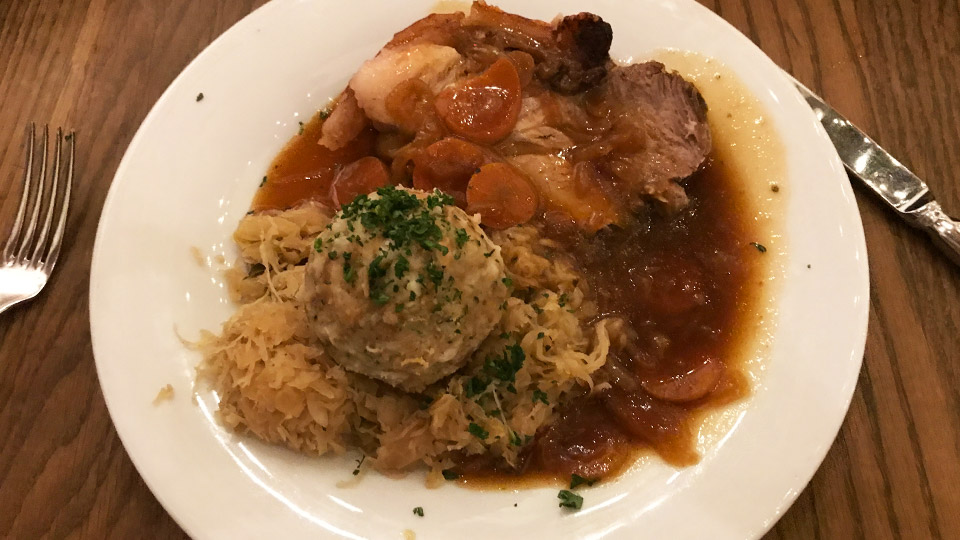 Pork meal at Stiftskeller Innsbruck Austria