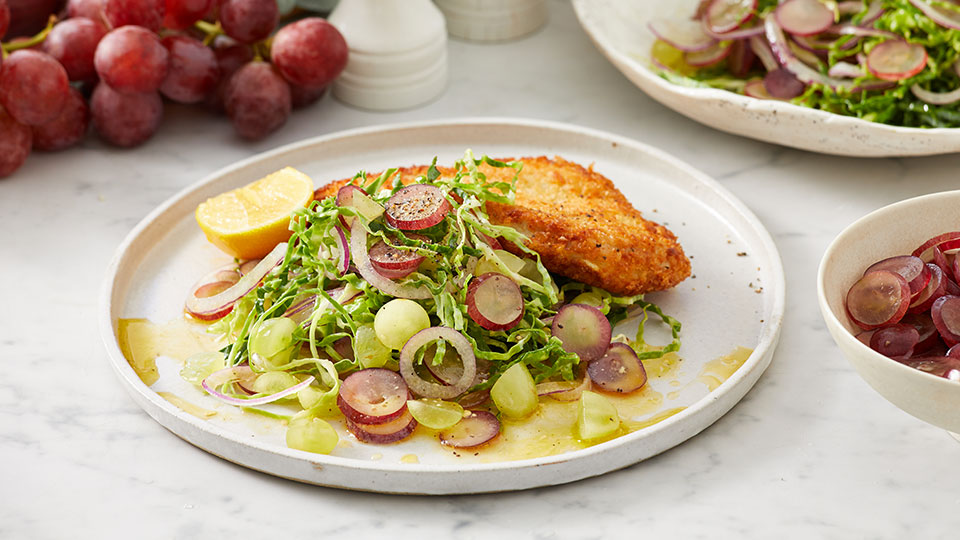 Chicken schnitzel with grape slaw